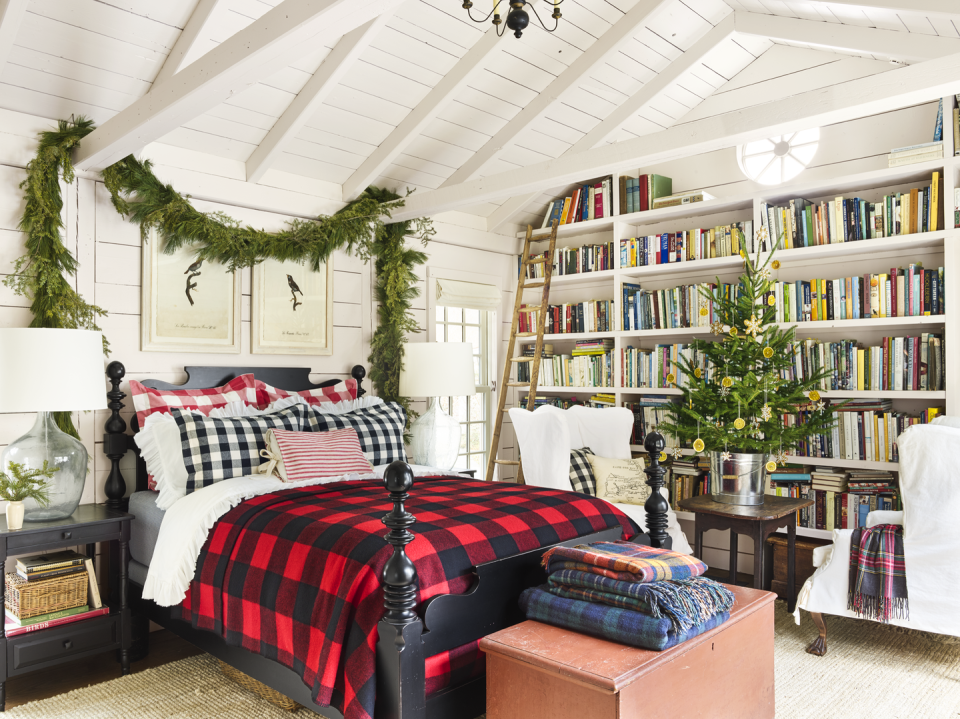 """<p>Transform your master bedroom into a Christmas wonderland with a buffalo check blanket, which you can throw over your existing bedding, and fresh garland hung above your headboard.</p><p><a class=""""link rapid-noclick-resp"""" href=""""https://www.amazon.com/Terrania-Buffalo-Blanket-Reversible-Catalonia/dp/B076LD9ZLL/?tag=syn-yahoo-20&ascsubtag=%5Bartid%7C10050.g.1247%5Bsrc%7Cyahoo-us"""" rel=""""nofollow noopener"""" target=""""_blank"""" data-ylk=""""slk:SHOP PLAID BLANKETS"""">SHOP PLAID BLANKETS</a></p>"""