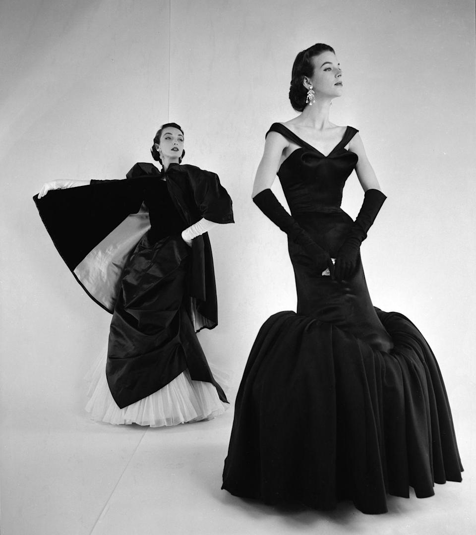 <p>On the cusp of the decade, this dramatic gown is a sort of hybrid of the 1940s column gowns and the full skirts of the1950s. </p>