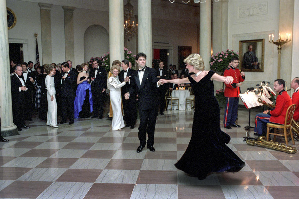 WASHINGTON, DC - NOVEMBER 9, 1985: In this handout image provided by The White House, Princess Diana dances with John Travolta in Cross Hall at the White House during an official dinner on November 9, 1985 in Washington, DC. (Photo by Pete Souza/The White House via Getty Images)