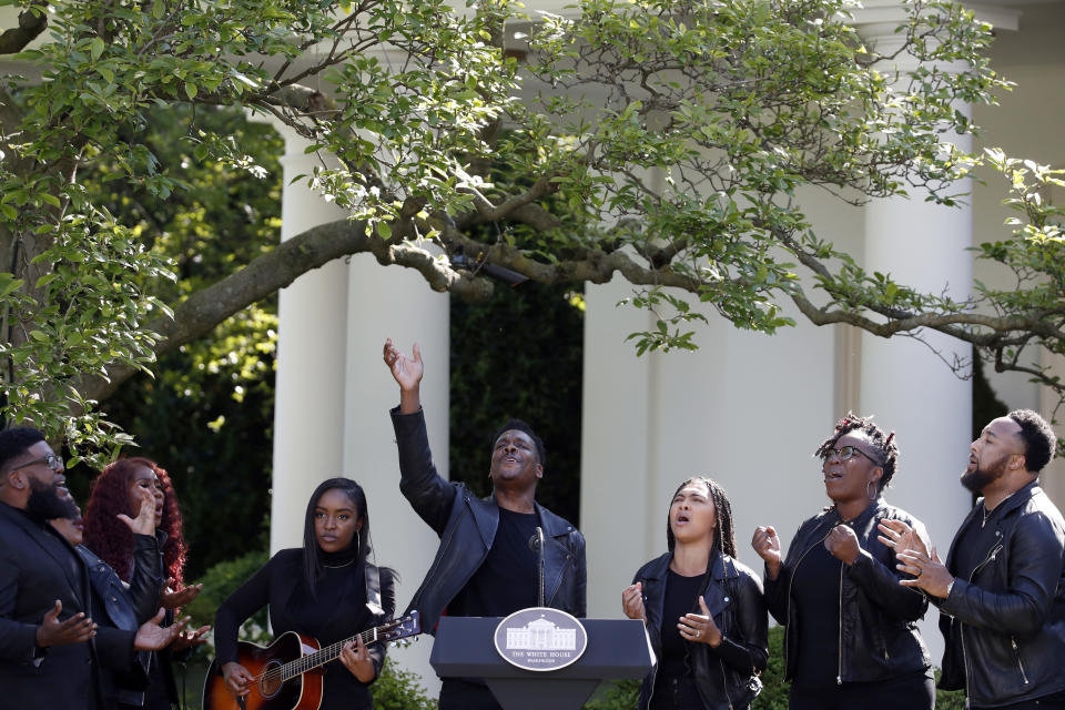 FILE - In this Thursday, May 7, 2020 file photo, The Spirit of Faith Christian Center Choir sings during a White House National Day of Prayer service in the Rose Garden of the White House in Washington. U.S. soldiers were fighting in Korea when President Harry S. Truman signed a Congressional resolution calling for an annual National Day of Prayer. The purpose was for the public to gather in houses of worship to pray for world peace, according to an Associated Press report from April 17, 1952. (AP Photo/Alex Brandon)