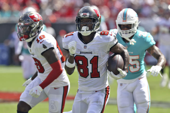 Tampa Bay Buccaneers wide receiver Antonio Brown (81) heads for the endzone to score on a 62-yard touchdown reception during the first half of an NFL football game against the Miami Dolphins Sunday, Oct. 10, 2021, in Tampa, Fla. (AP Photo/Mark LoMoglio)