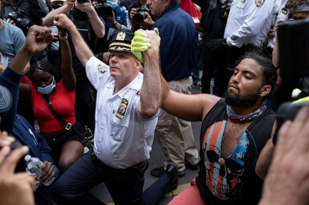PHOTO: Chief of Department of the New York City Police, Terence Monahan, takes a knee with activists as protesters paused while walking in New York, June 1, 2020. (Craig Ruttle/AP)