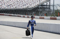 Driver Michael McDowell walks to his car before the start of the NASCAR Cup Series auto race Sunday, May 17, 2020, in Darlington, S.C. (AP Photo/Brynn Anderson)