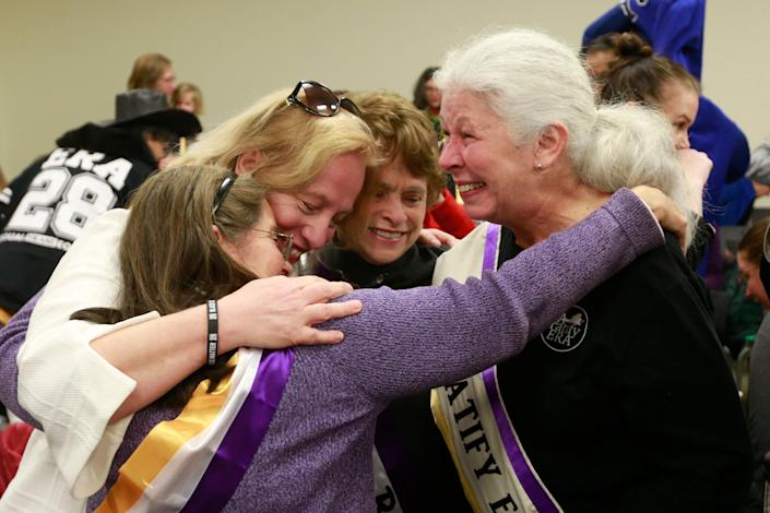 Supporters of the Equal Rights Amendment react to the Senate Privileges and Elections committee vote to report the ERA amendment the floor of the Senate during a Committee hearing at the Virginia State Capitol in Richmond, Va., Thursday, Jan. 9, 2020.