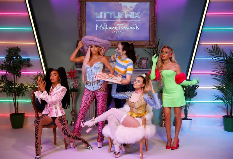 A waxworks artist at the unveiling of Little Mix waxwork figures at Madame Tussauds, in London