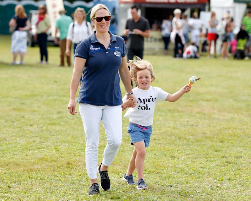 STROUD, UNITED KINGDOM - SEPTEMBER 15: (EMBARGOED FOR PUBLICATION IN UK NEWSPAPERS UNTIL 24 HOURS AFTER CREATE DATE AND TIME) Zara Tindall walks hand in hand with daughter Mia Tindall (eating an ice cream) as they attend day 3 of the Whatley Manor Gatcombe International Horse Trials at Gatcombe Park on September 15, 2019 in Stroud, England. (Photo by Max Mumby/Indigo/Getty Images)