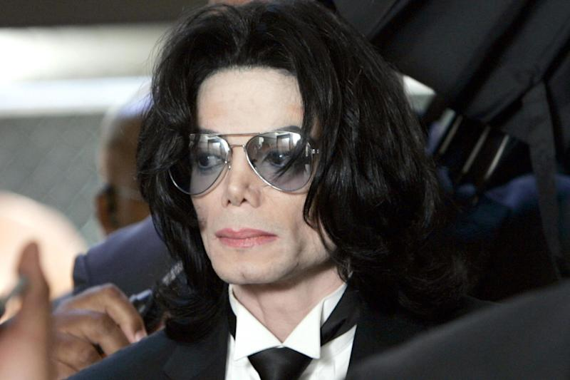 Michael Jackson prepares to enter the Santa Barbara County Superior Court to hear the verdict read in his child molestation case on 13 June, 2005 in Santa Maria, California: Kevork Djansezian-Pool/Getty Images