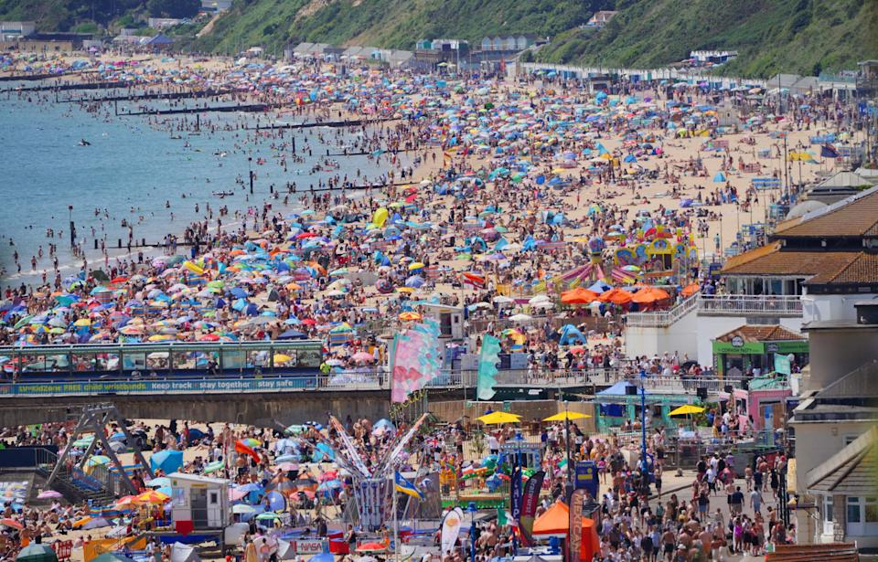 File photo dated 17/07/21 of people enjoying the weather on Bournemouth beach in Dorset. Humans are unequivocally driving global warming - with impacts from heatwaves to rising seas and extreme rain already seen around the world, a new UN report warns. Issue date: Monday August 9, 2021.
