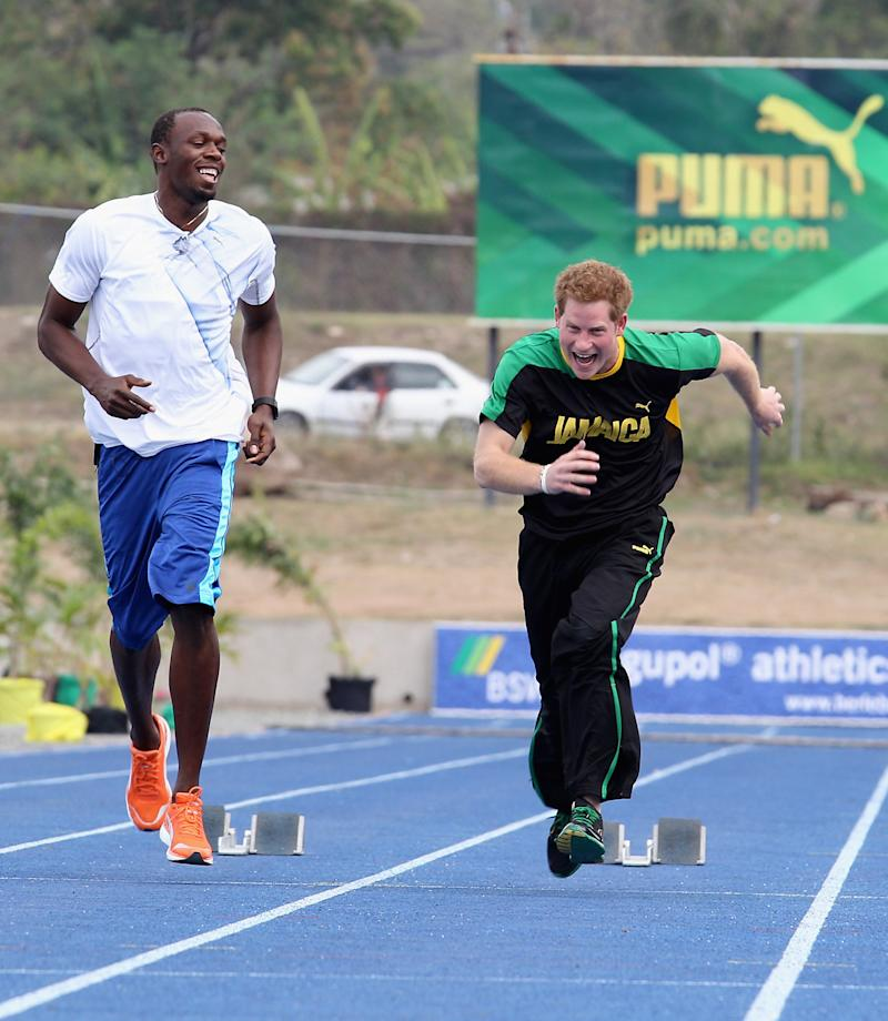 Harry races Usain Bolt at the University of the West Indies on March 6, 2012, in Kingston, Jamaica. (Chris Jackson via Getty Images)