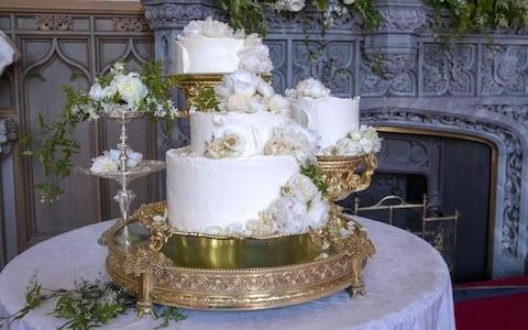 The wedding cake features elderflower syrup made at The Queens residence in Sandringham - Credit: AFP