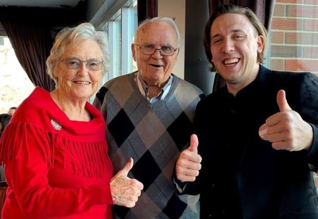 Kory Mathewson, right, with his grandparents Mufty and Bill Mathewson. He helped find a solution to a glitch in Alberta's online booking system for COVID-19 vaccine appointments. (Supplied by Kory Mathewson - image credit)