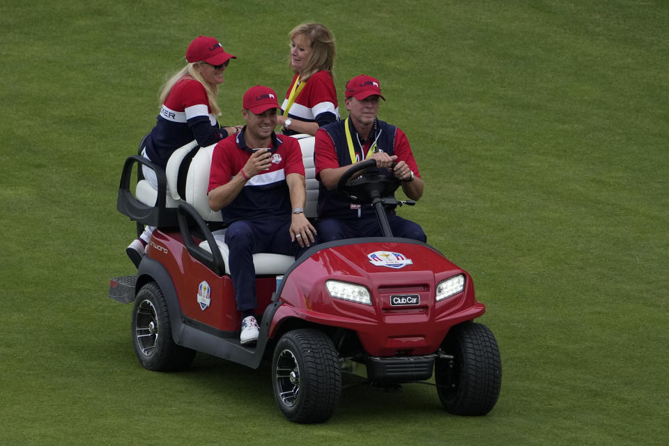 Team USA captain Steve Stricker gives Justin Thomas a ride after the Ryder Cup matches at the Whistling Straits Golf Course Sunday, Sept. 26, 2021, in Sheboygan, Wis. (AP Photo/Jeff Roberson)