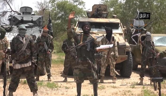A screengrab taken on July 13, 2014 from a video released by Boko Haram and obtained by AFP shows the leader of the Nigerian Islamist extremist group, Abubakar Shekau (C) (AFP Photo/)