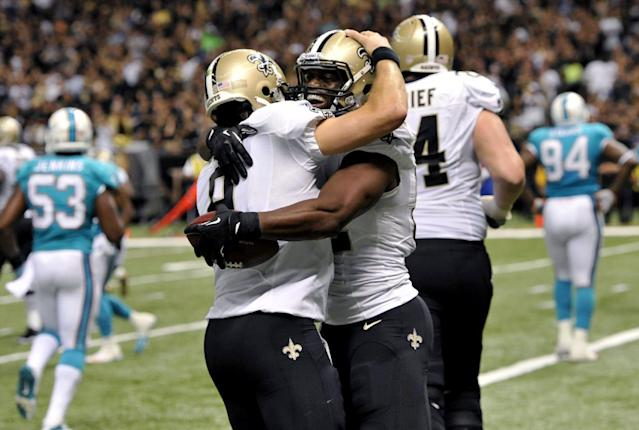 New Orleans Saints tight end Benjamin Watson celebrates his touchdown reception with quarterback Drew Brees (9) in the second half of an NFL football game against the Miami Dolphins in New Orleans, Monday, Sept. 30, 2013. (AP Photo/Bill Feig)