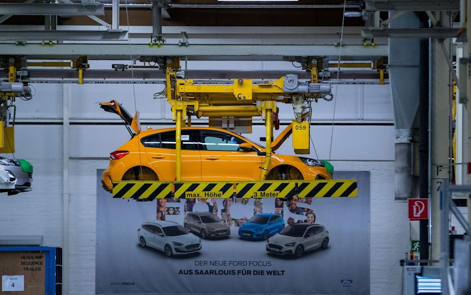 Cradles transport Ford Focus automobile bodies inside the Ford Motor Co. factory in Saarlouis, Germany, on Wednesday, Sept. 25, 2019
