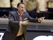 North Carolina State head coach Mark Gottfried calls a play for his team as they play Purdue in the first half of an NCAA college basketball game in West Lafayette, Ind., Tuesday, Dec. 2, 2014. (AP Photo/Michael Conroy)