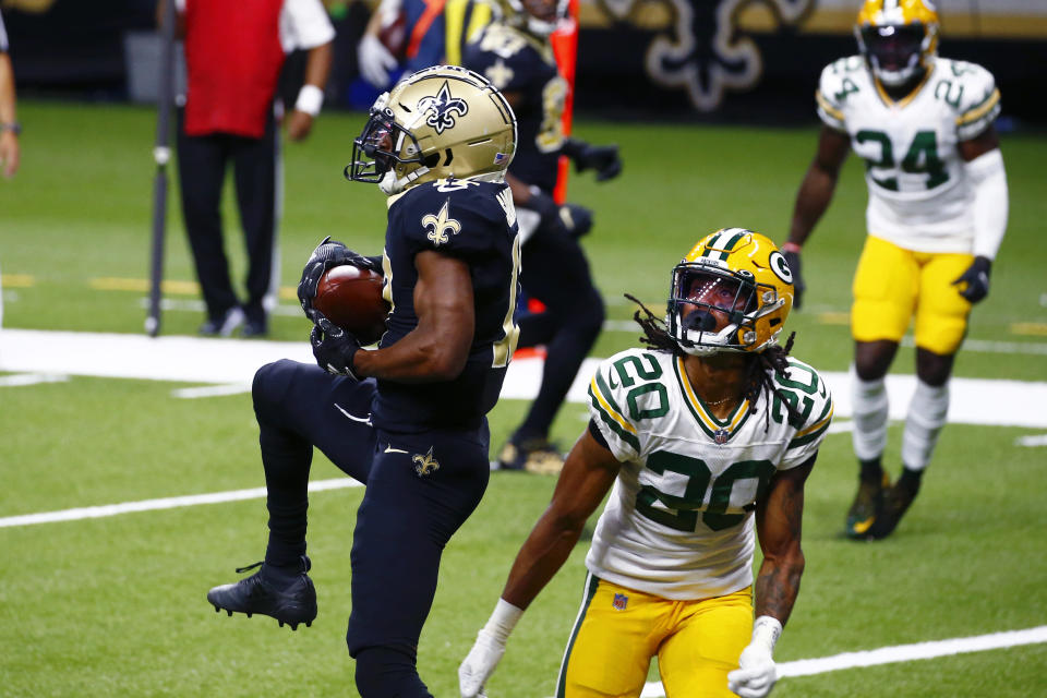 New Orleans Saints wide receiver Emmanuel Sanders (17) pulls in a touchdown reception over Green Bay Packers cornerback Kevin King (20) in the first half of an NFL football game in New Orleans, Sunday, Sept. 27, 2020. (AP Photo/Butch Dill)