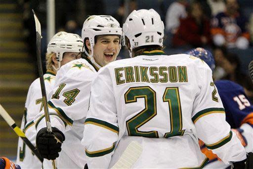 Dallas Stars left wing Jamie Benn (14) celebrates with Stars left wing Loui Eriksson (21) after Eriksson scored a goal in the first period of their NHL hockey game against the New York Islanders at Nassau Coliseum in Uniondale, N.Y., Thursday, Dec. 15, 2011. (AP Photo/Kathy Willens)