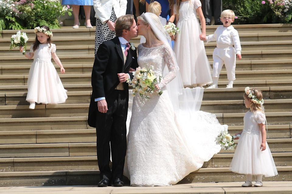<p>Prince Michael of Kent's daughter, who is known as Ella to friends and family, chose a white lace dress by Italian designer Luisa Beccaria for her special day. She paired the look with a fringe-style diamond tiara, a statement veil, and a lovely yellow bouquet.</p>