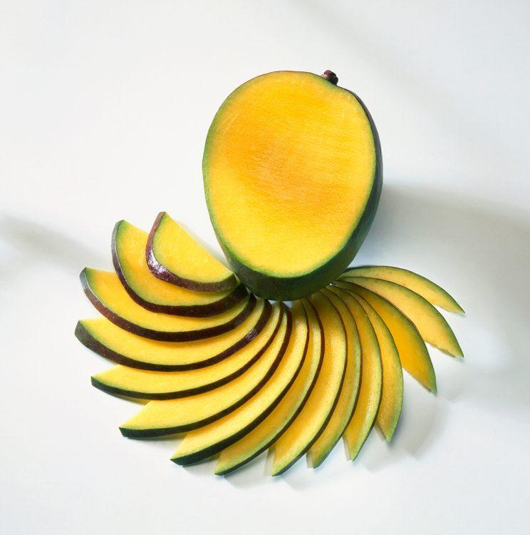 Fresh mango with slices fanned-out