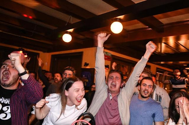 Kosovo Albanian supporters of Switzerland celebrate the winning goal scored by Xherdan Shaqiri in the World Cup Group E game between Serbia and Switzerland as they watch on TV in a pub in Pristina on June 22, 2018 (AFP Photo/Armend NIMANI)