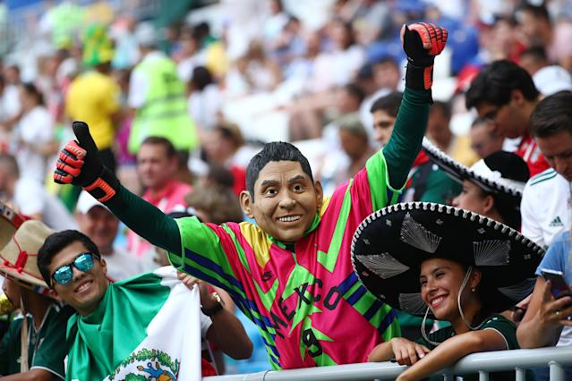 <p>Mexico fan wearing a mask inside the stadium before the match REUTERS/Pilar Olivares </p>