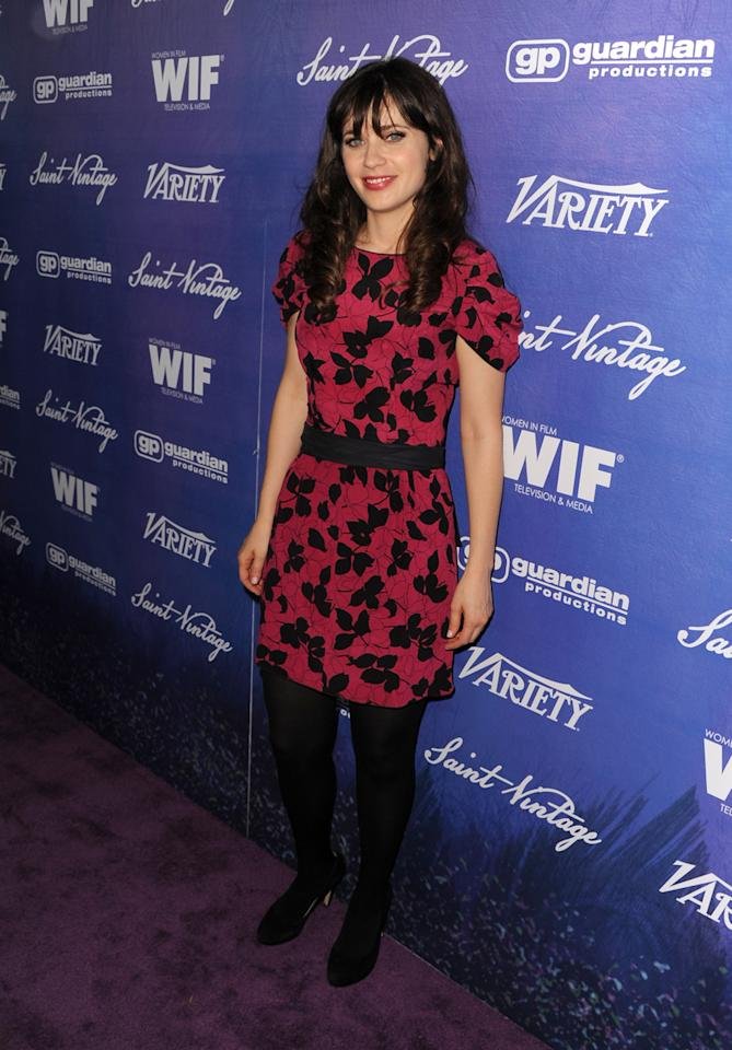 Actress Zooey Deschanel arrives at the Variety and Women in Film Pre-Emmy Event presented by Saint Vintage at Montage Beverly Hills on September 21, 2012, in Beverly Hills, California.