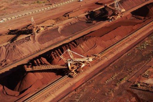 Handout photo from BHP Billiton shows iron ore being stockpiled for export in Western Australia. Analysts say government spending in Australia was weakening despite the mining boom