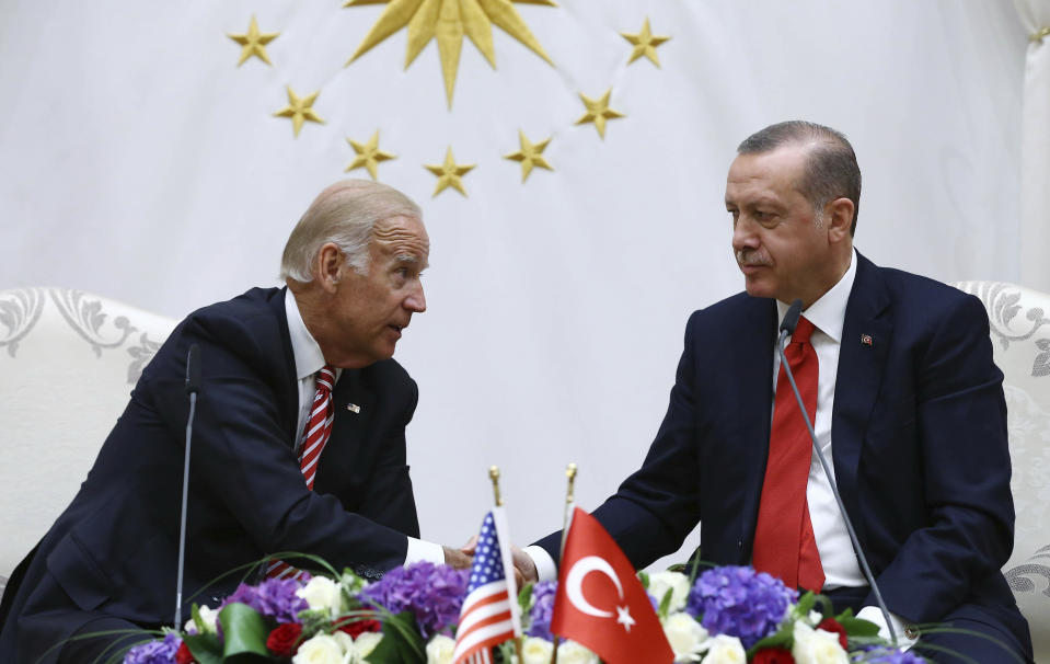 FILE- In this Wednesday, Aug. 24, 2016 file photo, then U. S. Vice President Joe Biden, left, talks to Turkey's President Recep Tayyip Erdogan during a meeting in Ankara, Turkey. Erdogan has toned down his anti-Western and anti-US rhetoric in an apparent effort to reset the rocky relationship with his NATO allies. So far, however, he's been met by silence from U.S. President Joe Biden. Nearly two months into his presidency, Biden still hasn't called Erdogan, which some in Turkey see as a worrying sign. (Kayhan Ozer, Presidential Press Service Pool via AP, File)