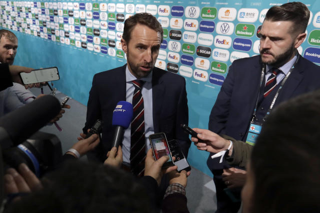 England coach Gareth Southgate talks to journalists after the draw for the UEFA Euro 2020 soccer tournament finals in Bucharest, Romania, Saturday, Nov. 30, 2019. (AP Photo/Petr David Josek)
