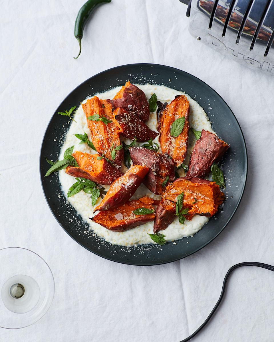 """This twice-roasted method allows for the sweet potatoes to get super-creamy on the inside while their skins get a little crispy. <a href=""""https://www.bonappetit.com/recipe/roasted-sweet-potatoes-with-chile-yogurt-and-mint?mbid=synd_yahoo_rss"""" rel=""""nofollow noopener"""" target=""""_blank"""" data-ylk=""""slk:See recipe."""" class=""""link rapid-noclick-resp"""">See recipe.</a>"""