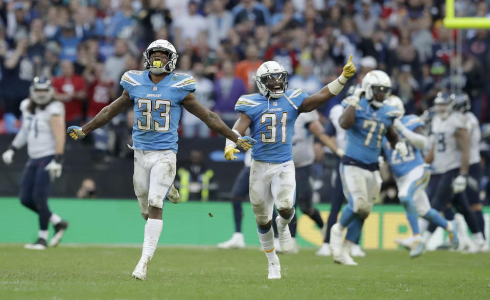 Los Angeles Chargers defensive backs Adrian Phillips and Derwin James celebrate after the Chargers prevented the Tennessee Titans from converting the potentially game-winning two-point play. (AP)