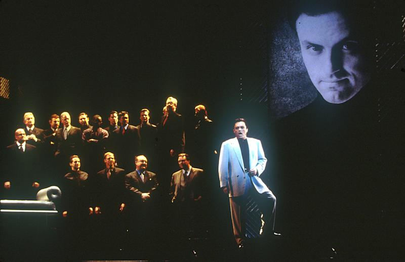 "This March 2000 photo released by the Los Angeles Opera shows tenor Frank Lopardo as Duke, right, performing with the chorus in ""Rigoletto,"" in Los Angeles. The first of Giuseppe Verdi's three great middle period triumphs has been shifted before to New York's Little Italy, Federico Fellini's Rome, modern-day Hollywood and even the Oval Office. Now it will take place amid dazzling Sin City lights and not in the Renaissance Palazzo Ducale when Michael Mayer's version of the 162-year-old classic opens Monday night. (AP Photo/Los Angeles Opera, Ken Howard)"