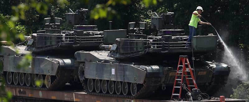 WASHINGTON, DC - JULY 02: A worker washes one of two M1A1 Abrams tanks that are loaded on rail cars at a rail yard on July 2, 2019 in Washington, DC. President Trump asked the Pentagon for military hardware, including tanks, to be displayed during Thursdays July 4th Salute to America celebration at the Lincoln Memorial. (Photo by Mark Wilson/Getty Images)