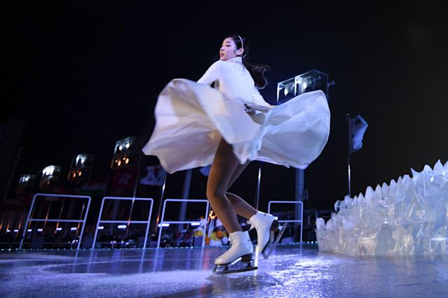 <p>South Korean figure skater Kim Yu-na performs during the opening ceremony of the Pyeongchang 2018 Winter Olympic Games at the Pyeongchang Stadium on February 9, 2018. / AFP PHOTO / POOL / FRANCK FIFE </p>