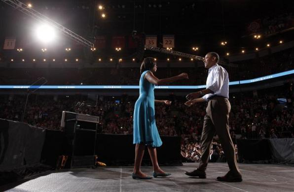 President Barack Obama and first lady Michelle Obama embrace during a campaign rally at the Ohio State University in Columbus, Ohio May 5, 2012. Obama officially kicked off his re-election campaign today with visits to Ohio and Virginia.