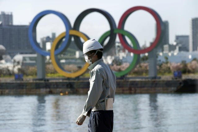 Organizers are moving forward with the Tokyo Olympics as coronavirus concerns persist. (AP Photo/Eugene Hoshiko)
