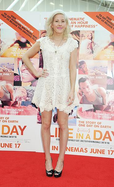 """<div class=""""caption-credit""""> Photo by: Getty Images</div><div class=""""caption-title"""">On the red carpet for the Life in a Day UK premiere in 2011</div>Trading in her hip rockstar leather and studs for a white lace skater dress, Ellie was sweet as sugar on the red carpet."""