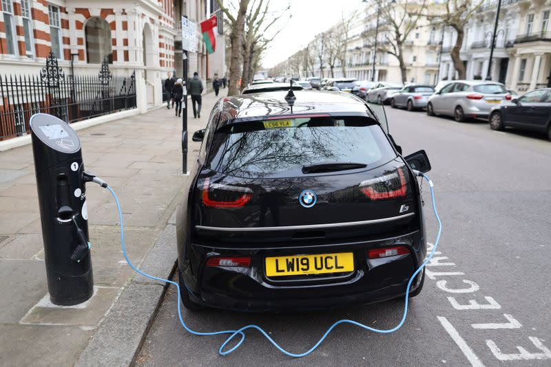 Electric car charges on a street in London
