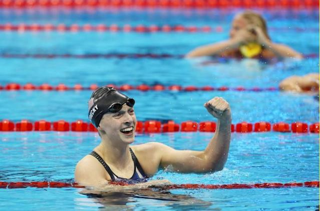 <p>Katie Ledecky of the United States celebrates after winning a gold medal in the Women's 200m Freestyle Final on Day 4 of the Rio 2016 Olympic Games. REUTERS/Stefan Wermuth </p>