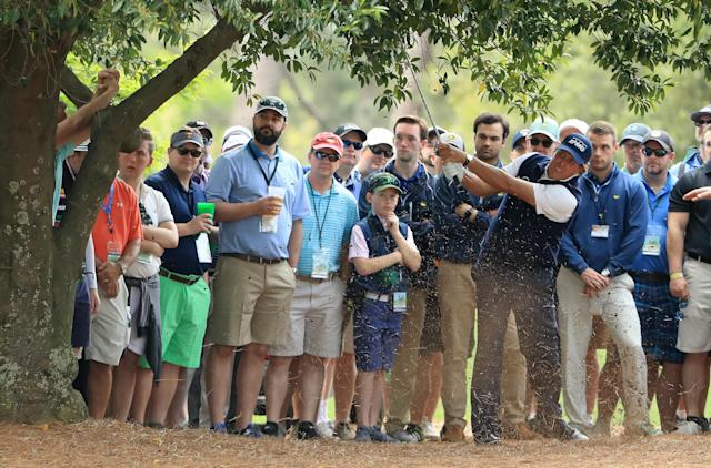 Phil Mickelson hits out of the trees on No. 9 during the second round of the 2018 Masters Tournament at Augusta National Golf Club on April 6, 2018 in Augusta, Georgia. (Getty)