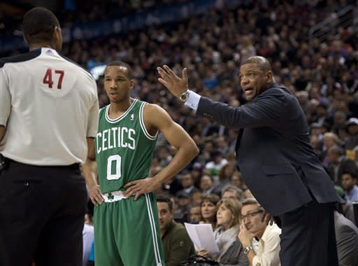 Boston Celtics guard Avery Bradley (0) listens as head coach Doc Rivers, right, yells at referee Bennie Adams (47) after getting a technical foul during first -half NBA basketball game action in Toronto, Wednesday, Feb. 6, 2013. (AP Photo/The Canadian Press, Frank Gunn)