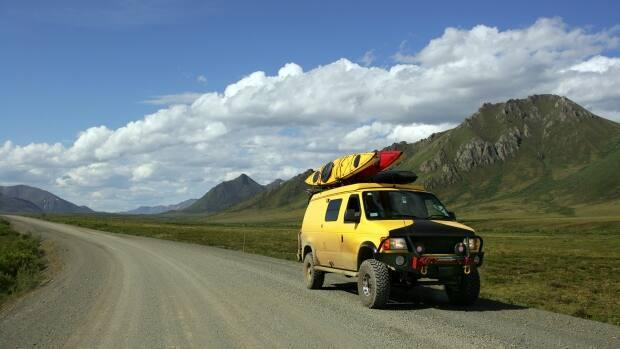 A van travels on the Dempster Highway. Travellers from Yukon headed to the N.W.T. can now apply to skip self-isolation, after both ferries on the N.W.T.'s side of the Dempster Highway began their service for the year. (iStock - image credit)