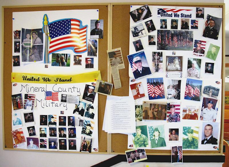In this Aug. 10, 2011 photo, a bulletin board on display at the Mineral County Courthouse in Superior, Mont., celebrates the county's military recruits. Even with recruiting numbers down, Superior remains a patriotic place, where lots of homes fly the U.S. flag.  (AP Photo/Nicholas K. Geranios)
