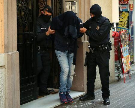 Spain nabs 9 terror suspects, probes links to Brussels, Paris attacks