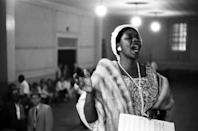 """<p>Dinah Washington was primarily a vocalist during her career, but also played jazz piano, often to accompany her lyrics. She's known as """"Queen of the Blues,"""" <a href=""""http://www.economist.com/node/3172481"""" rel=""""nofollow noopener"""" target=""""_blank"""" data-ylk=""""slk:once telling her audience during a 1959 show in Britain"""" class=""""link rapid-noclick-resp"""">once telling her audience during a 1959 show in Britain</a>; """"I'm happy to be here, but just remember — there's one heaven, one earth, and one queen: Elizabeth is an imposter!"""" Washington's vocal power and energy made her one of the most-loved musicians of her time, and her opulent style made for exciting performances. <i>(Photo: Getty Images)</i></p>"""