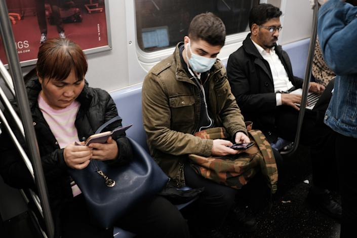 NEW YORK, NEW YORK - MARCH 11: A man wears a medical mask on the subway as New York City confronts the coronavirus outbreak on March 11, 2020 in New York City. President Donald Trump announced on Wednesday evening that he is restricting passenger travel from 26 European nations to the U.S. in an effort to contain the coronavirus which is rapidly spreading throughout the world and America.  (Photo by Spencer Platt/Getty Images)