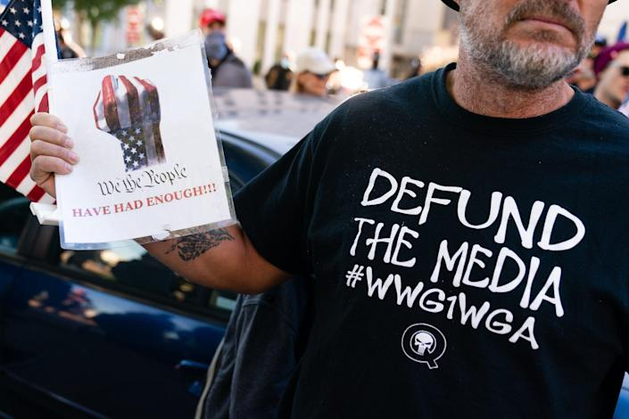 "<p>File Image: A man wearing a 'Defund the Media' QAnon shirt is seen at a ""Stop the Steal"" rally against the results of the U.S. Presidential election outside the Georgia State Capitol on November 18, 2020 in Atlanta, Georgia</p> (Getty Images)"
