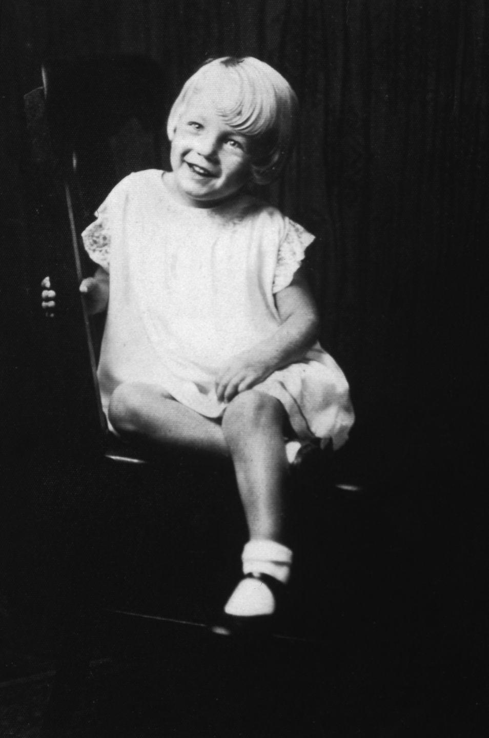 <p>Norma's beautiful smile is revealed in this portrait when she's five years old. </p>