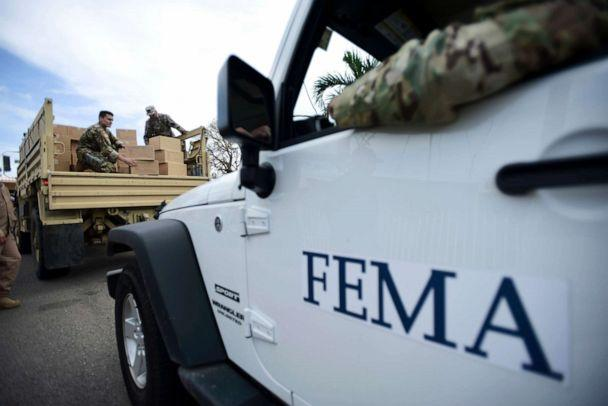 PHOTO: Department of Homeland Security personnel deliver supplies to Santa Ana community residents in the aftermath of Hurricane Maria in Guayama, Puerto Rico, Oct. 5, 2017. (Carlos Giusti/AP, FILE)
